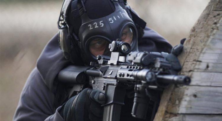 Man shooting using a rifle with simmons scope