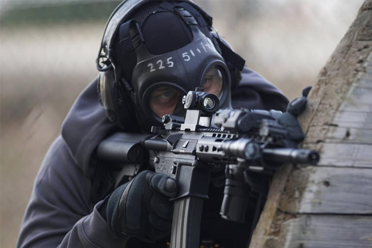 swat member on his rifle