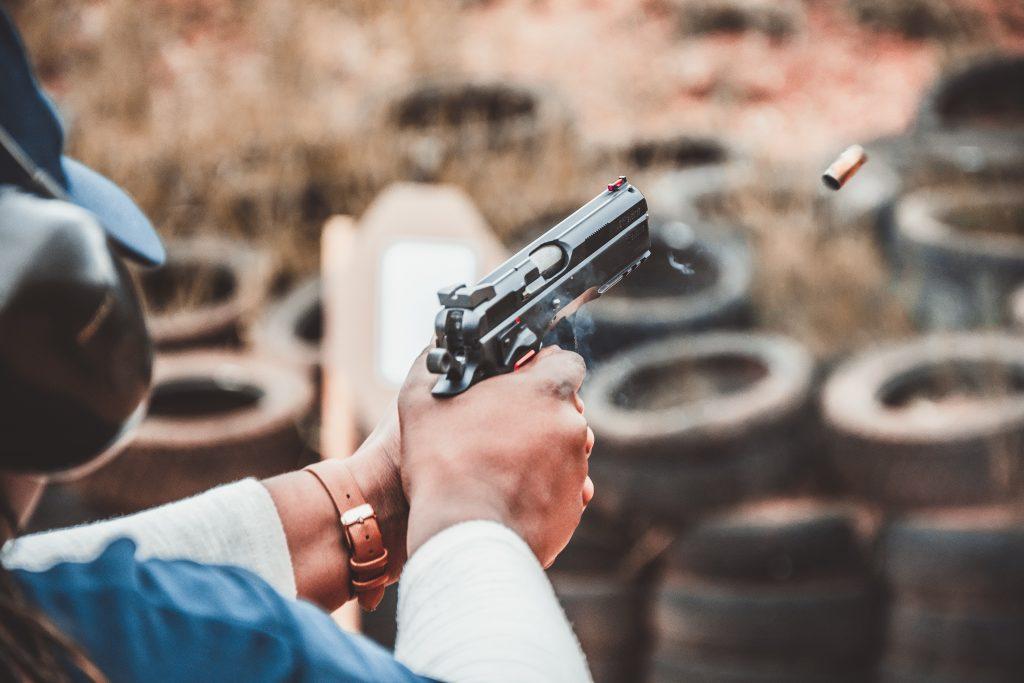 person firing a gun