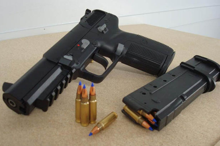pellet gun with the magazine removed and shells emptied