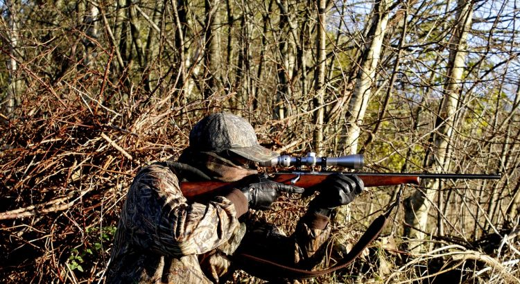 a hunter using a rifle with ffp scope