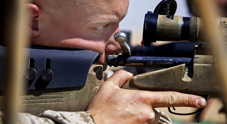 a soldier looking through one of the first focal plane scopes