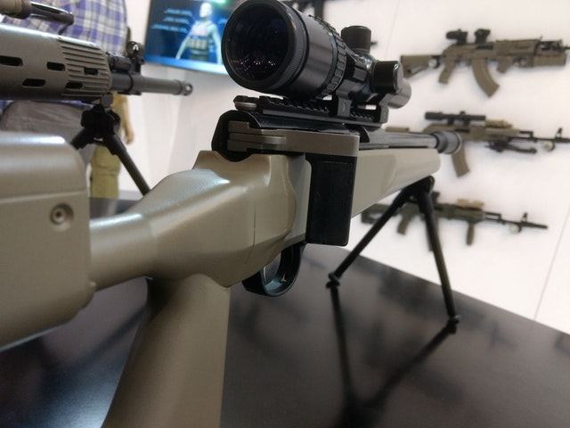 a sniper scope attached to a replica gun