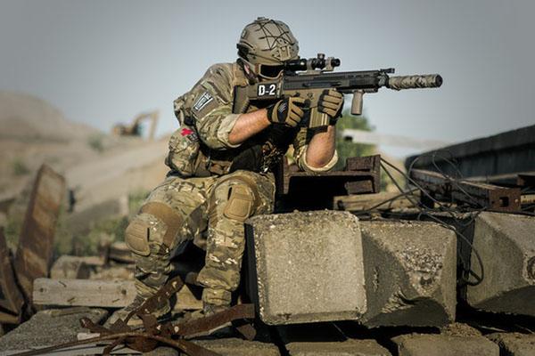 soldier using  gun with scope