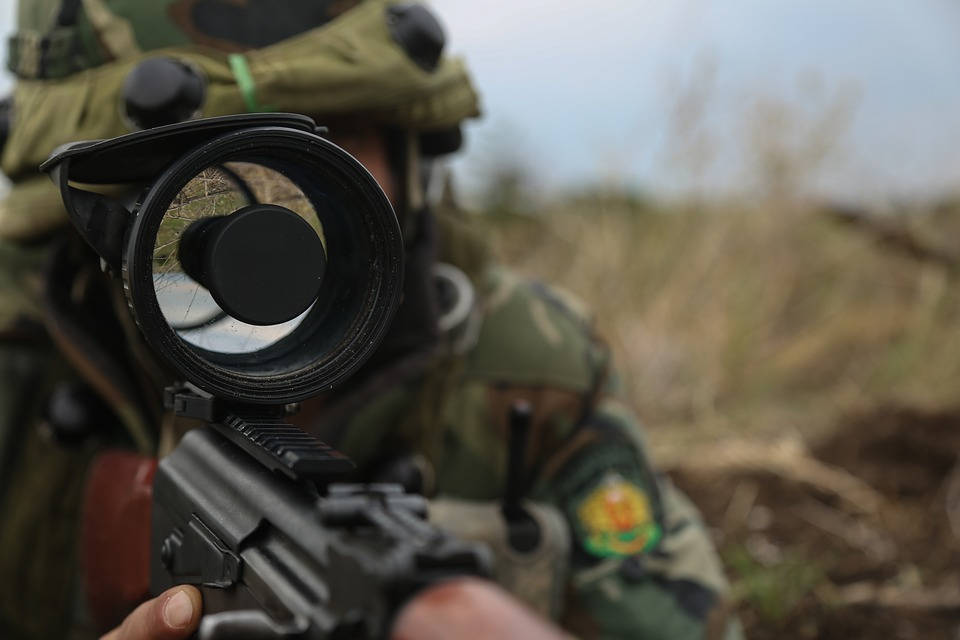 soldier using a rifle scope